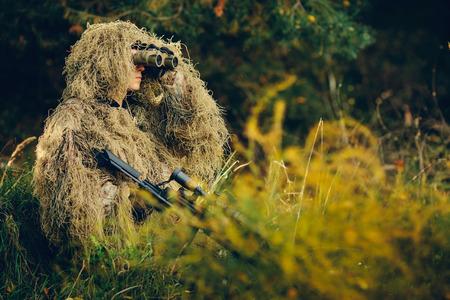 Hunter watching through binoculars purpose