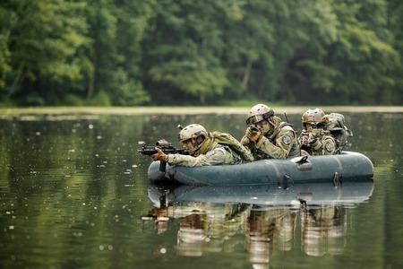 operator in a boat sailing ahead 写真素材