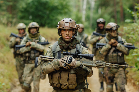 soldier: soldier stands with arms together with other Stock Photo