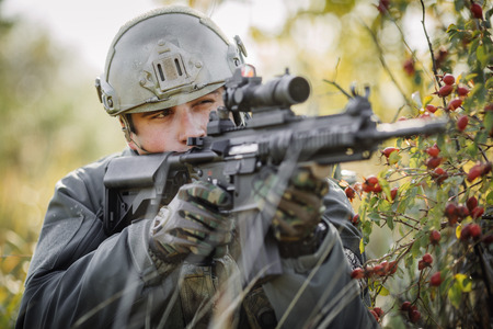 military sniper aiming an assault rifle photo