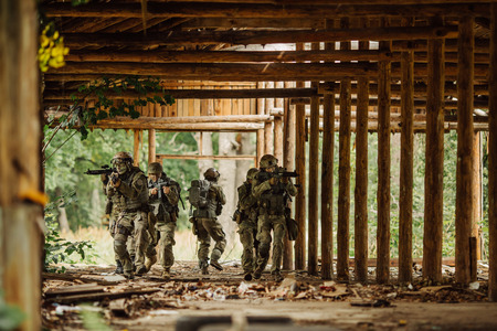 stormed: group rangers stormed the building Stock Photo