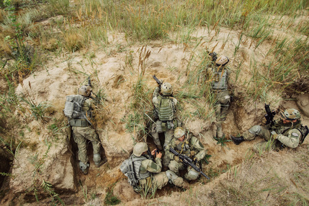 trenches: group of warriors hiding in the trenches and firing