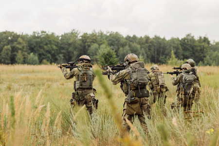 military training: group of  rangers conducting an offensive against the enemy