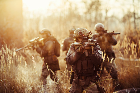 military forces: rangers  with a rifle aiming at a target Stock Photo