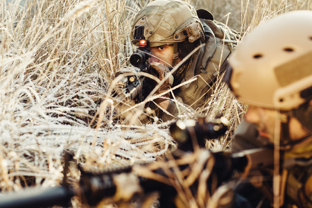two rangers in an ambush aim at the enemy Stock Photo