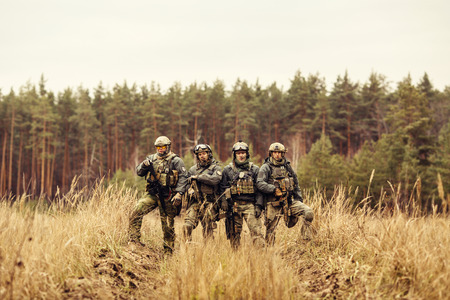 military special forces: group of rangers standing and looking at the camera