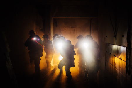 Night Ranger military operation commandShot of a real military operation late at night. Real life rangers team shot on location. Since this locations are the real thing, and not shot in an \