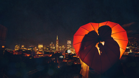 Silhouette of bride and groom on the background of a big city Stock Photo