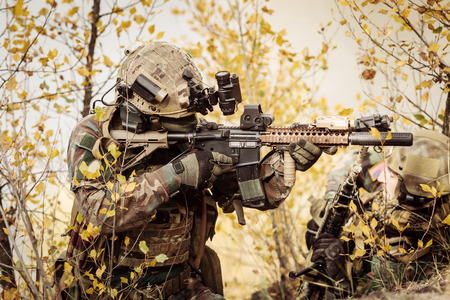 Rangers team aiming at a target of weapons Stock Photo