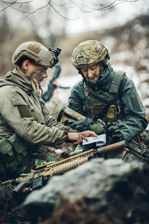 nato: rangers on the Outdoor of looking at the map