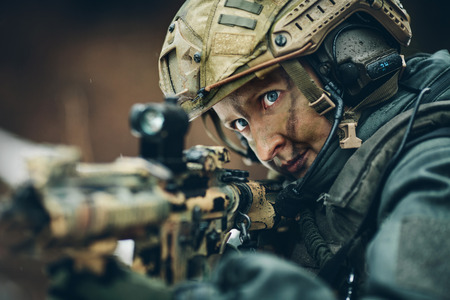 armed woman in camouflage with sniper gun in hands Standard-Bild