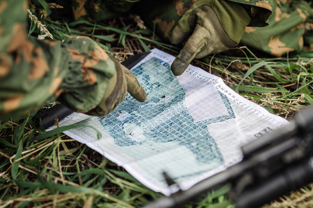 explains: Ranger commander explains the combat mission and points to a paper map