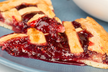 Image of delicious raspberry pie on a blue plate