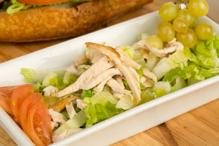 Image of fresh tasty and healthy salad on a wooden board