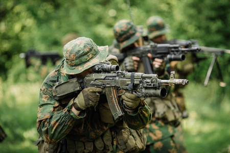 separatist: Group of soldiers Russian special forces during the raid in the forest