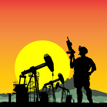 iraq war: US soldier with oil rigs on the background Stock Photo