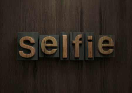 Selfies - Wood letterpress block. 3d illustration