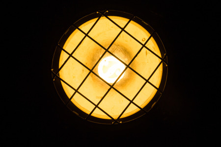 Lamps shining a golden yellow light in a dark room