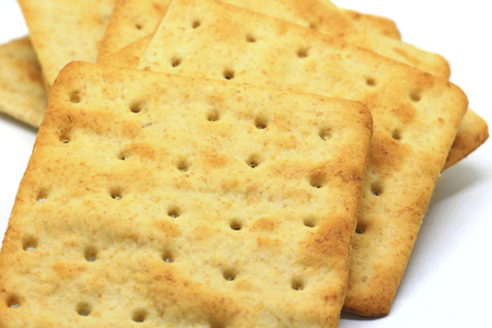 whole wheat flour crackers close up on a white background