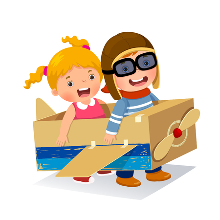 Creative boy playing as a pilot with cardboard airplane
