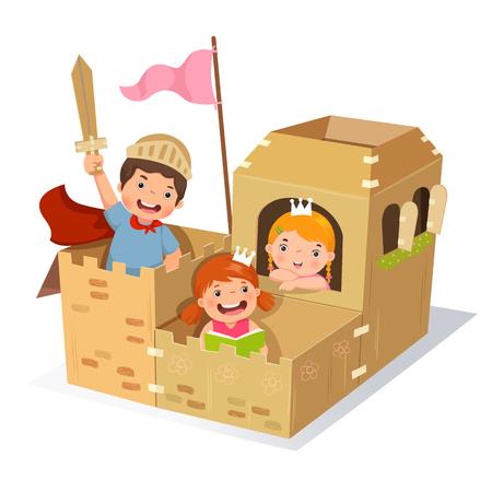 Kreatywne dzieci grające zamek wykonane z kartonu