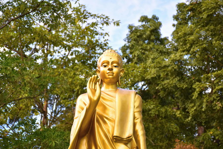 persuading: Buddha image. The attitude of persuading the relatives not to quarrel