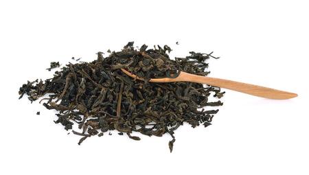 dry black tea leaves isolated on white Stock Photo