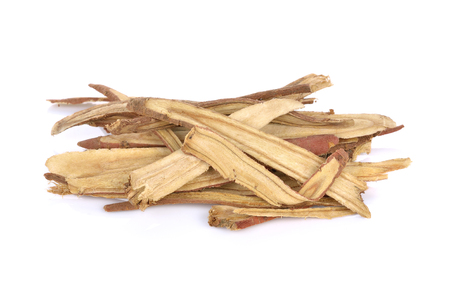 Slice Licorice roots on white background Stock Photo