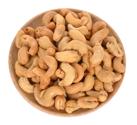 Bowl with cashews on a white background.