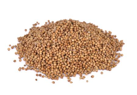Pile of coriander seeds on white background  Stok Fotoğraf