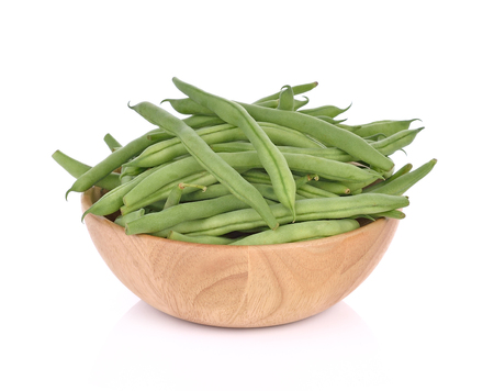 Green beans  in wood bowl on a white background.