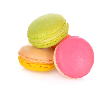 French colorful macarons isolated on a white background