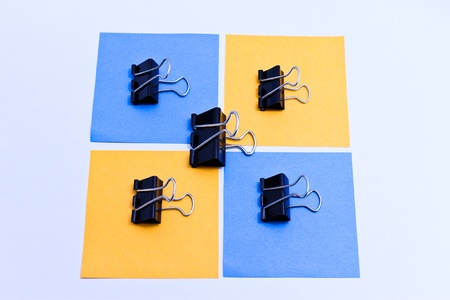 Clips black placed on color paper