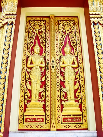 Ancient art pattern on the wooden door in Thai temple photo