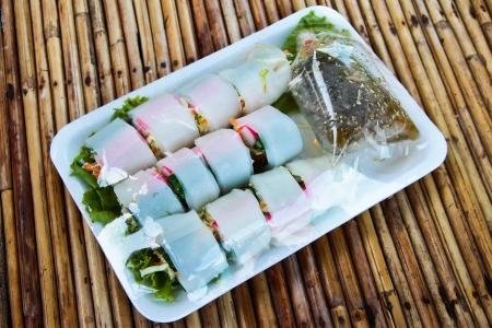 Spring rolls, put in foam tray  photo