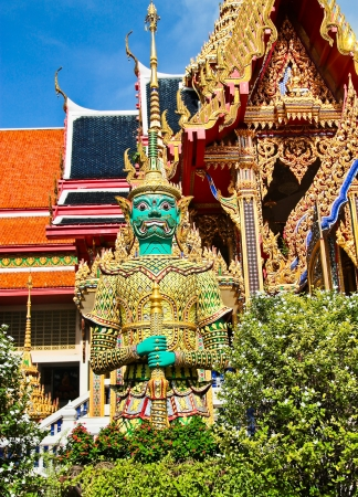 Giant guardian at Temple of the Emerald Buddha in Bangkok, Thailand photo
