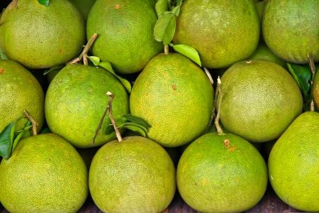 Pomelo fruit on shelves