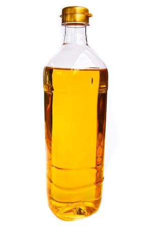 vegetable oil in a plastic bottler on white background
