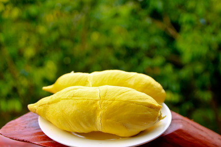 peeled durian on plate in the garden