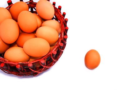 Egg in basket on white background