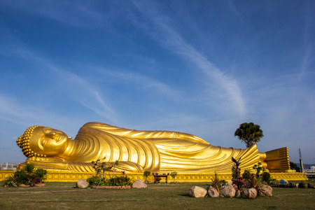 smiling buddha: Reclining Buddha with blue sky in Songkhla province, Thailand