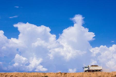 dumptruck: The truck running on sand soil
