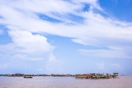Floating houses beside Tonle Sap Lake in Siem Reap, Cambodia  photo