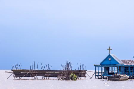 Floating church beside Tonle Sap Lake in Siem Reap, Cambodia photo