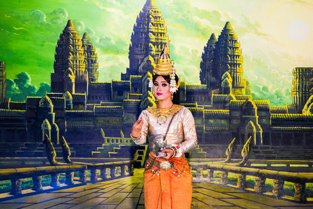 headress: SIEM REAP, CAMBODIA - May 3, 2014  Khmer classical dancers performing in full traditional costumer May 3, 2014 in Siem Reap, Cambodia  Angkor Wat is the most visited place in Cambodia  Editorial