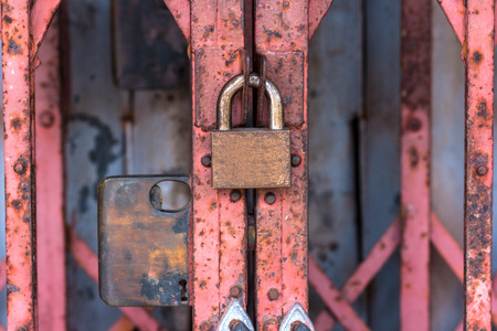 keylock: Old locked Padlock on the red door, safety concept