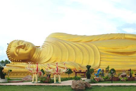 veneration: Golden Reclining Buddha, Songkhla, Thailand