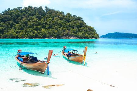 long tailed boat: LIPE, SATUN, THAILAND - SEP 27, 2014: Fisherman sailed longtail boat to visit beautiful beach of Koh Lipe, Thailand