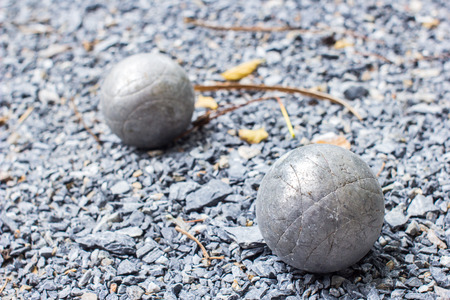 bocce: Used petanque balls on a sandy ground