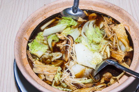 teh: Bak kut teh with fresh vegetables Stock Photo